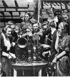 800px-Club_holds_radio_dance_wearing_earphones_1920